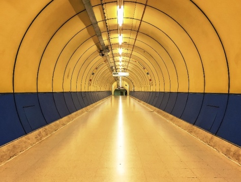 Through the 1980s King's Cross Thameslink foot tunnel (still open 0700 - 2000 weekdays) with its huge SMILE prints mid-way) but on this Saturday visit was eerily quiet