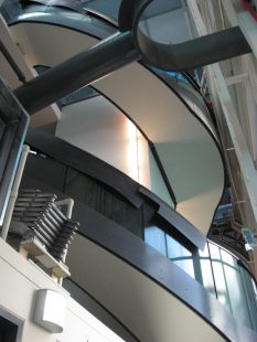 Looking up at the spiral stair around the lift shaft at the southern end of the new mezzanine floor