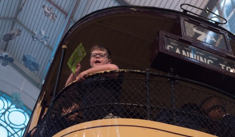 A pupil on the top deck of a tram in the Museum