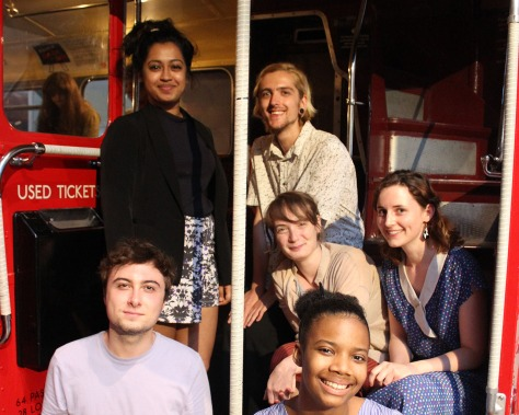 Image of the six young freelancers aboard a vintage bus in the museum.