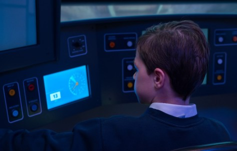Boy on an Elizabeth Line tube driver simulator