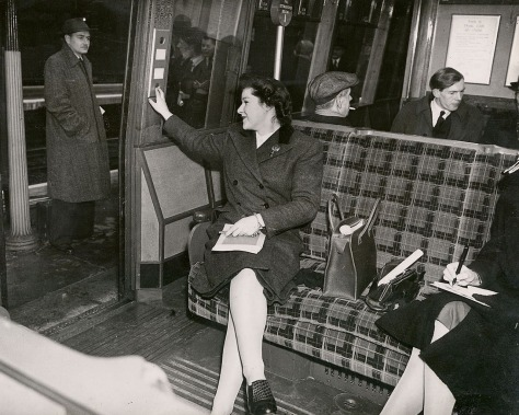 black and white image of people on a train.