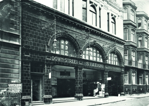 Black and white photo of the entrance of Down Street station