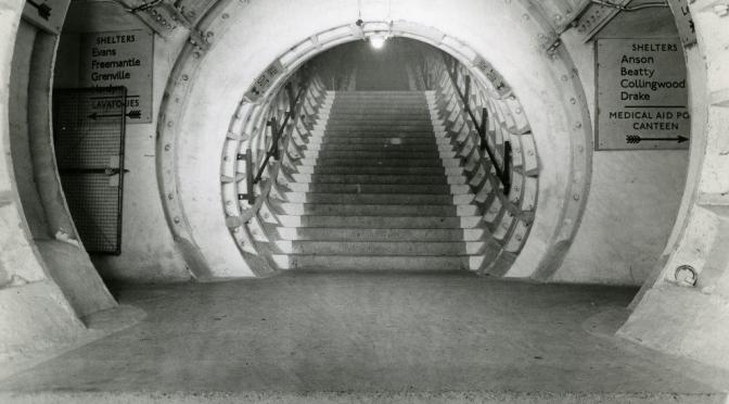 Black and white shot of a staircase in an underground tunnel