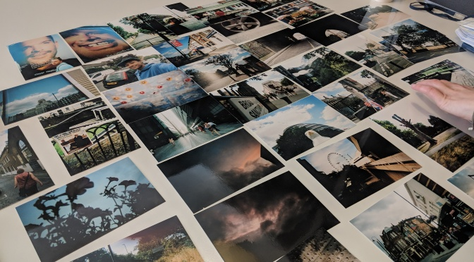 A series of photographs laid out on a table