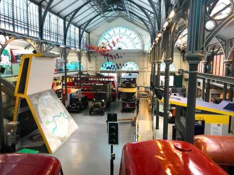 Inside London Transport Museum looking down over the vehicles from the first floor