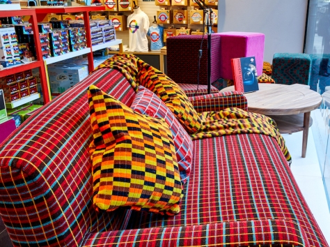 A moquette sofa and Routemaster fabric, with two District line cushions and a throw on top
