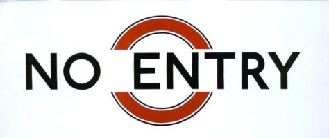 White enamel sign with red disc and black lettering reading No Entry